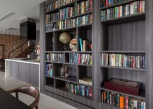 Twin bookshelves that conceal a hidden passageway to the study and guest room