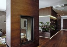 Two-sided-fireplace-in-the-living-room-also-delineates-space-217x155