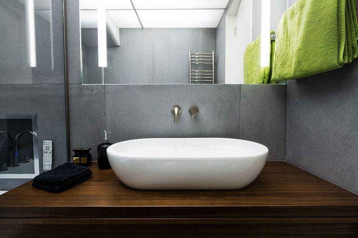 Walnut oak vanity inisde the stylish bathroom