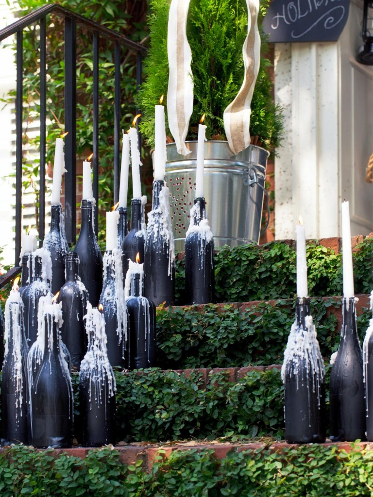 Wine bottles with dripping taper candles