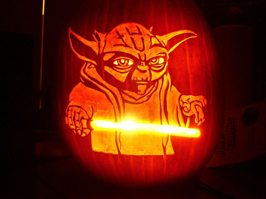 Yoda pumpkin stencil with light saber is a showstopper! [From: instructables]
