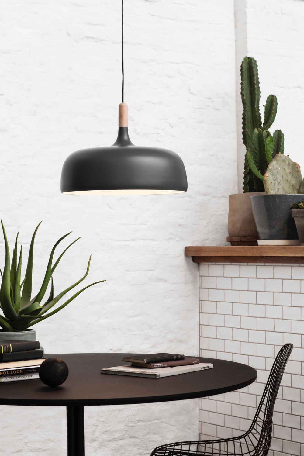 Designed by Atle Tveit, Acorn (in grey) is a contemporary pendant whose shape is inspired by Norwegian autumn forests and the oak acorn.
