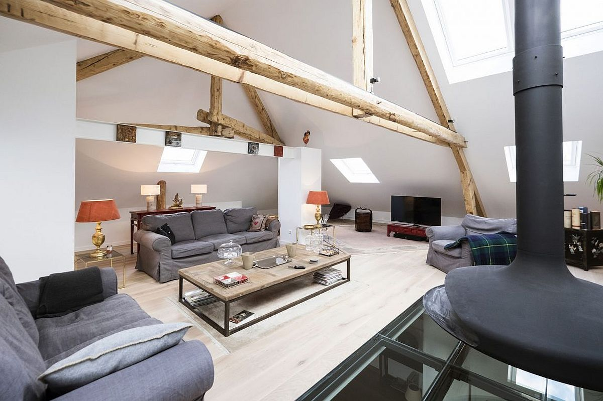 Attic living room of renovated 1920s manor house in Luxembourg