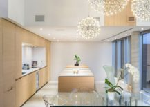 Beautiful globe pendant lights coupled with lovely recessed lighting in the dining room and kitchen