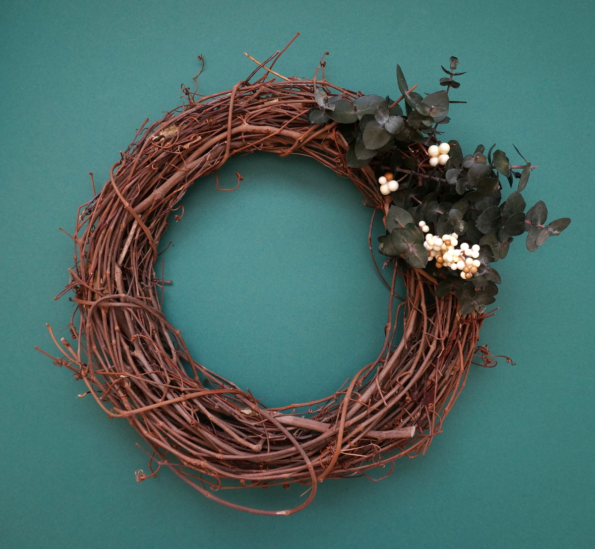 Begin decorating the top of the wreath