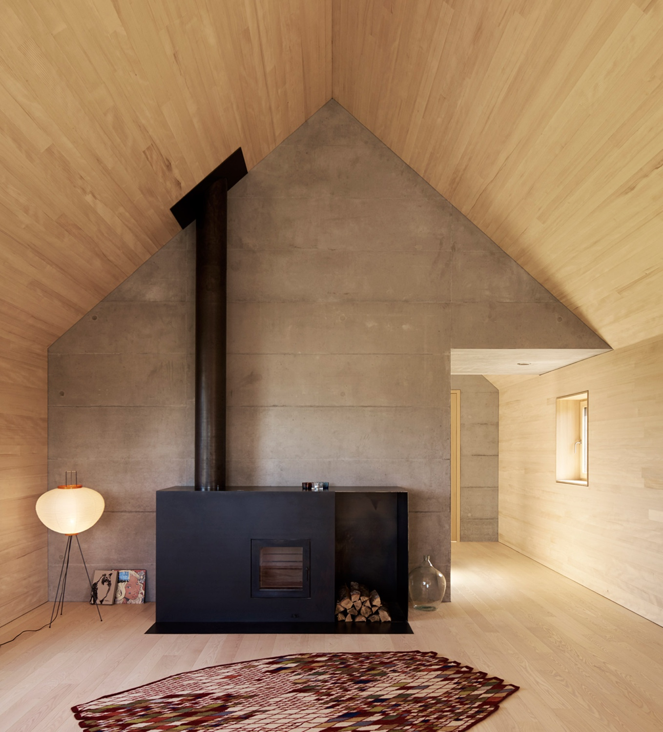 A cosy wood burning stove in an Austrian home designed by Bernardo Bader Architekten. Photo by Adolf Bereuter via Dezeen.