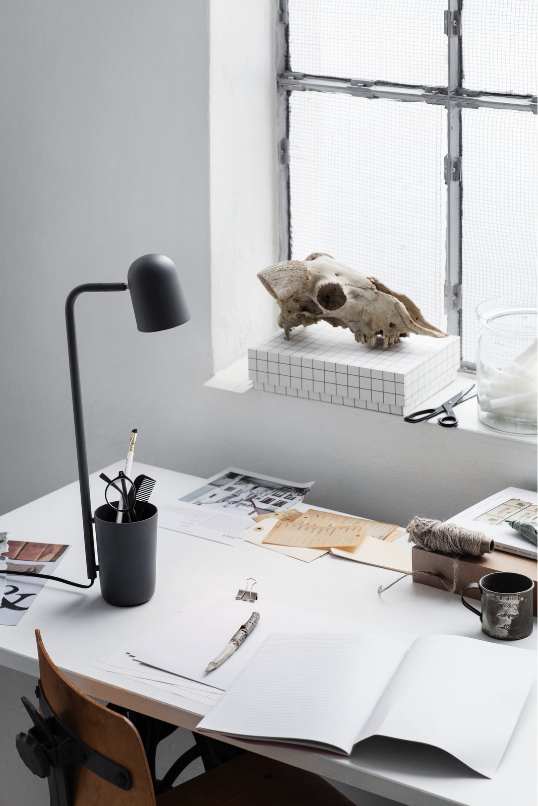 Designed by Mads Sætter-Lassen, Buddy (pictured in dark grey) is an unassuming little helper and desk companion.