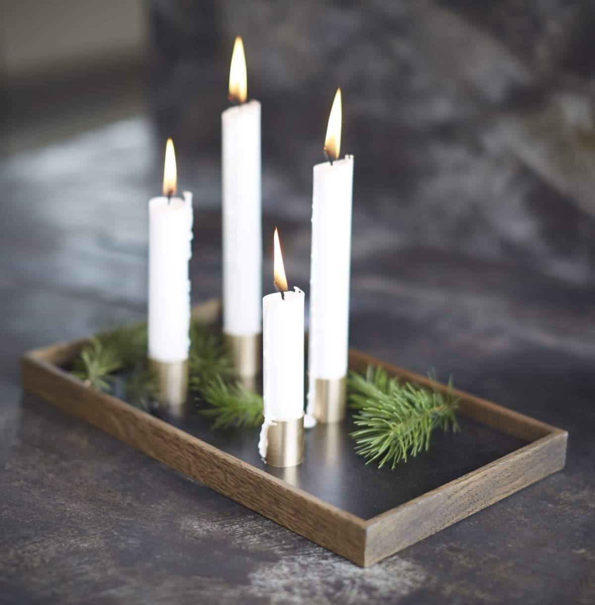Candle Tray De Luxe with a black oiled frame andmagnetic candle holders made from solid brass.