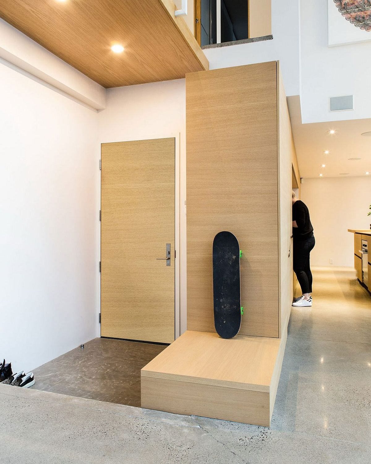 Carefully concealed storage space and becnh at the entrance of the Montreal penthouse