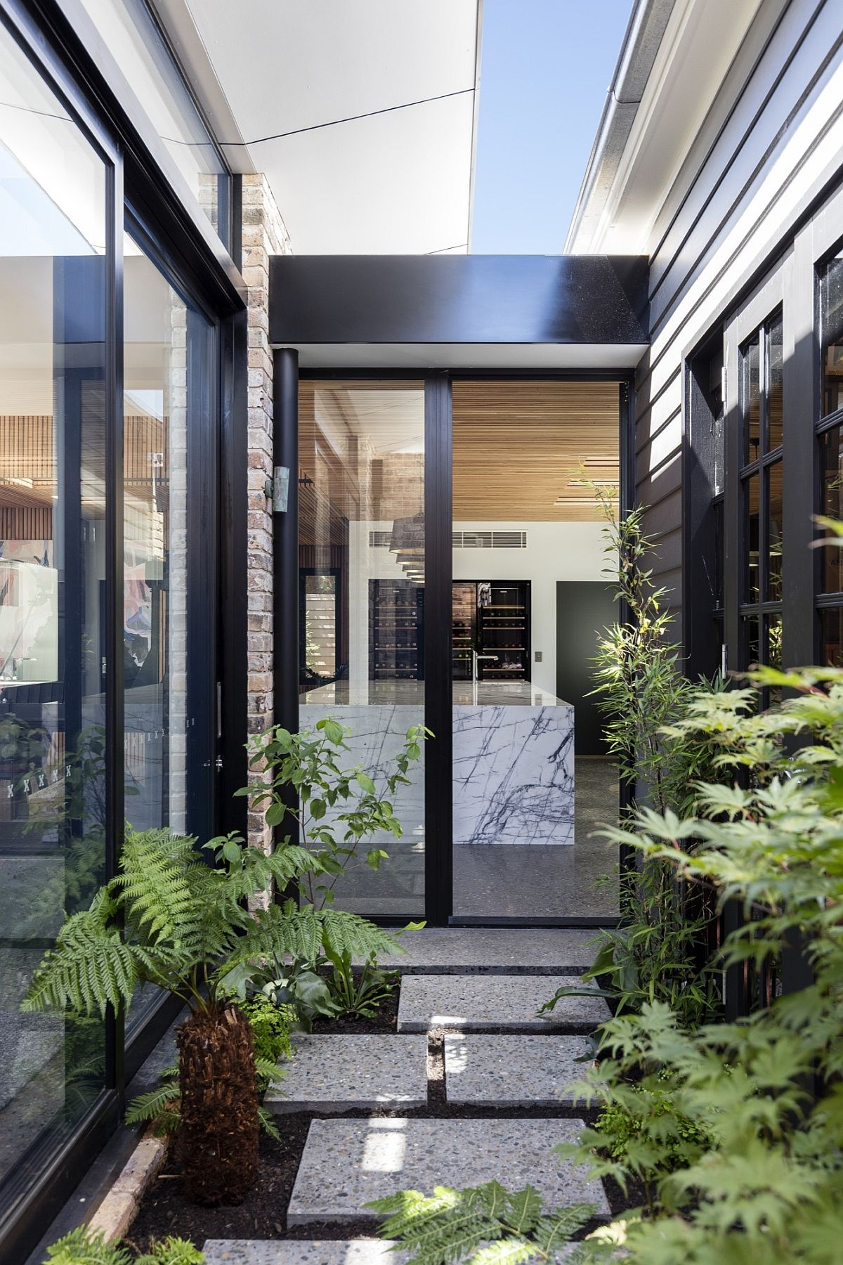 Central courtyard of the revamped Aussie home with greenery