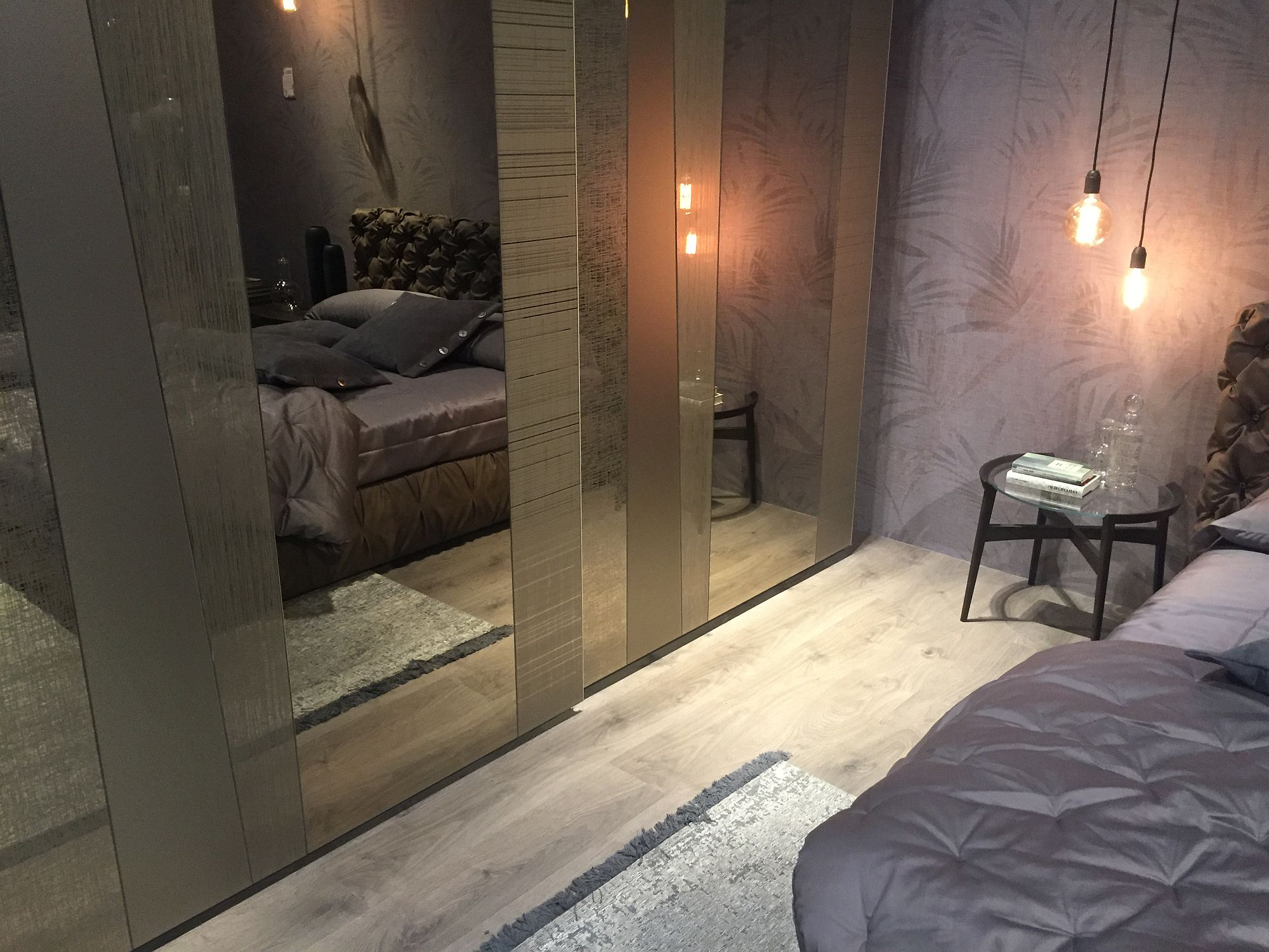 Closer look at the trendy mirrored bedroom closets