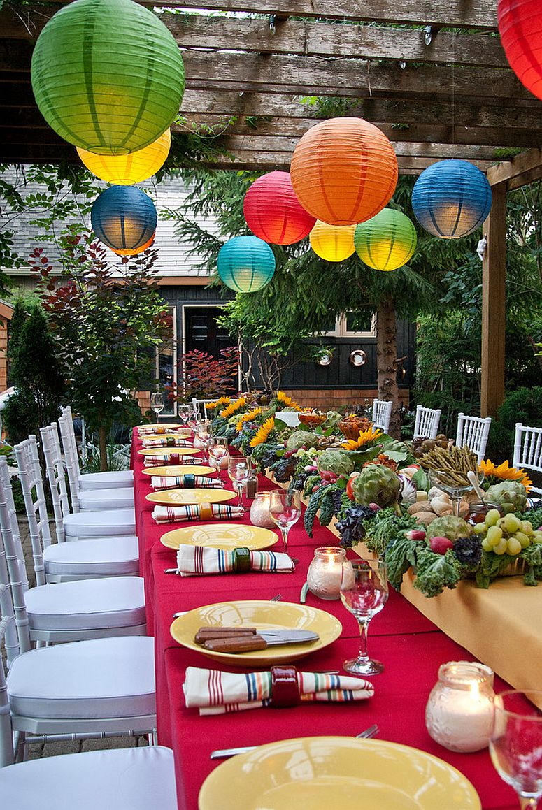 Colorful lighting for outdoor Thanksgiving dinner [Design: Terri Clark Interiors]