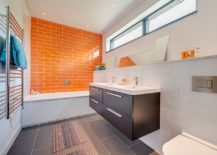 It should come as no surprise that any bold color works well with the millions of shades of gray when used right. A bathroom clad in neutral hues also ...
