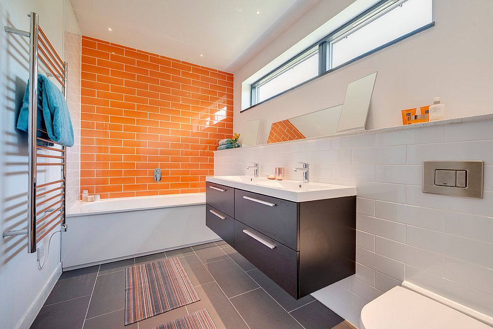 Contemporary bathroom in white, orange and gray [Design: van Ellen + Sheryn Architects]