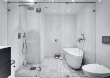 Contemporary bathroom in white with glass shower area