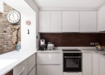 Contemporary cabinets in white give the kitchen an ergonomic and stylish makeover