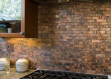 Copper tiles create a cool backsplash in the traditional kitchen