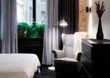 Cozy-reading-corner-in-the-bedroom-with-floor-lamp-217x155