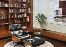 Cozy reading zone next to the bookshelf with the Eames Lounger