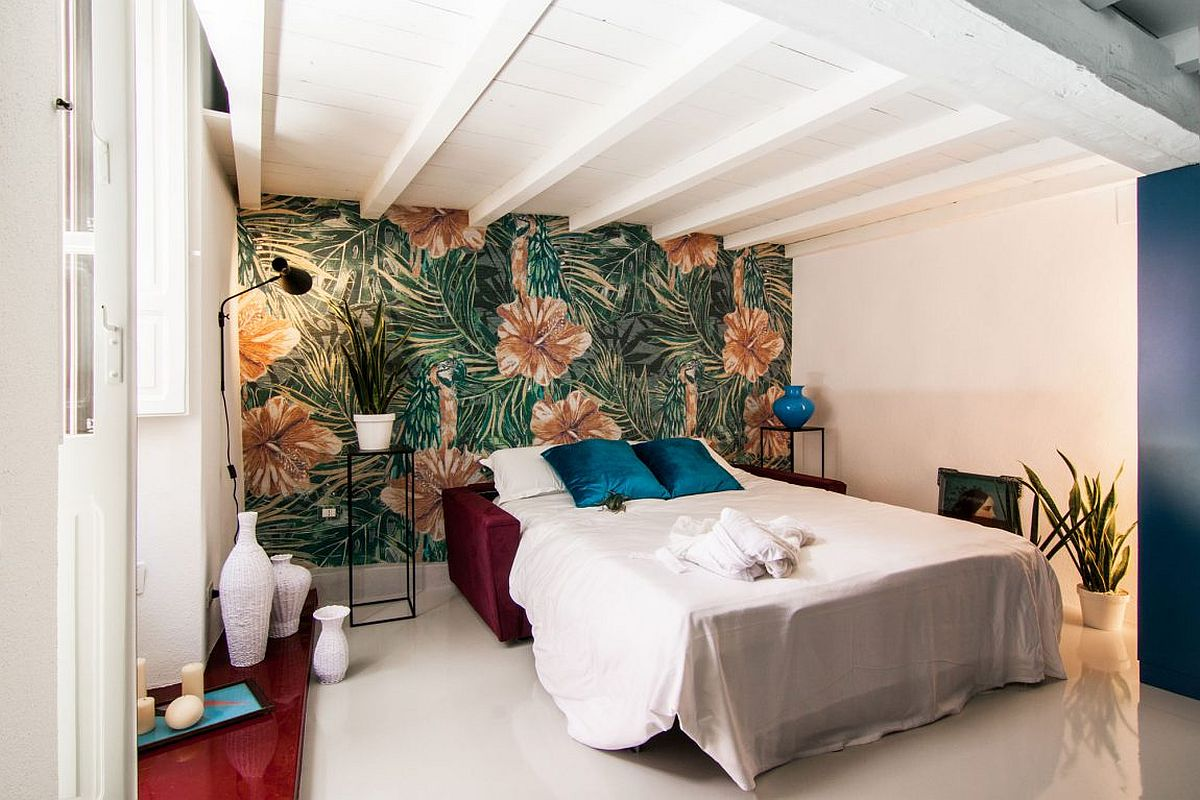 Custom wall mural in the bedroom adds both color and patterm
