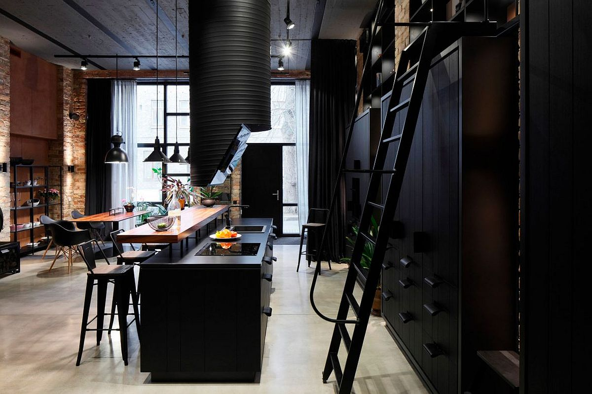 Dark kitchen in black with wooden breakfast counter