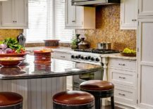 Dashing kitchen backsplash brings golden hue to the kitchen