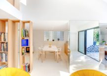 Dining-room-and-kitchen-concealed-behind-the-glass-pillar-and-the-bookshelves-217x155