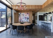 Dining room and kitchen with sliding glass doors and weatherboard backdrop