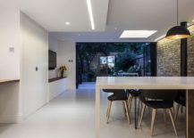 Elegant modern extension in white of classic London home