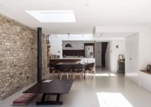 Exposed brick wall adds character and uniqueness to the white interior 217x155 Light, Space and a Cheerful Family Zone: Modern Extension of London Home