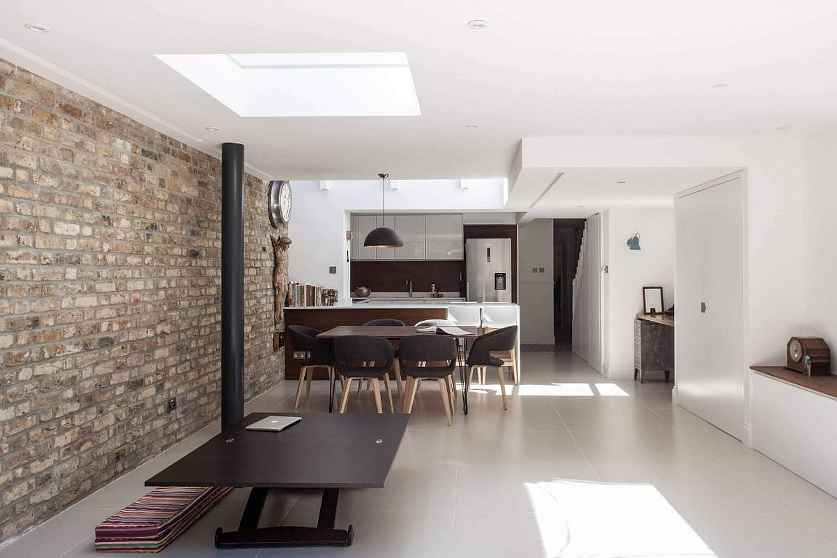 Exposed brick wall adds character and uniqueness to the white interior
