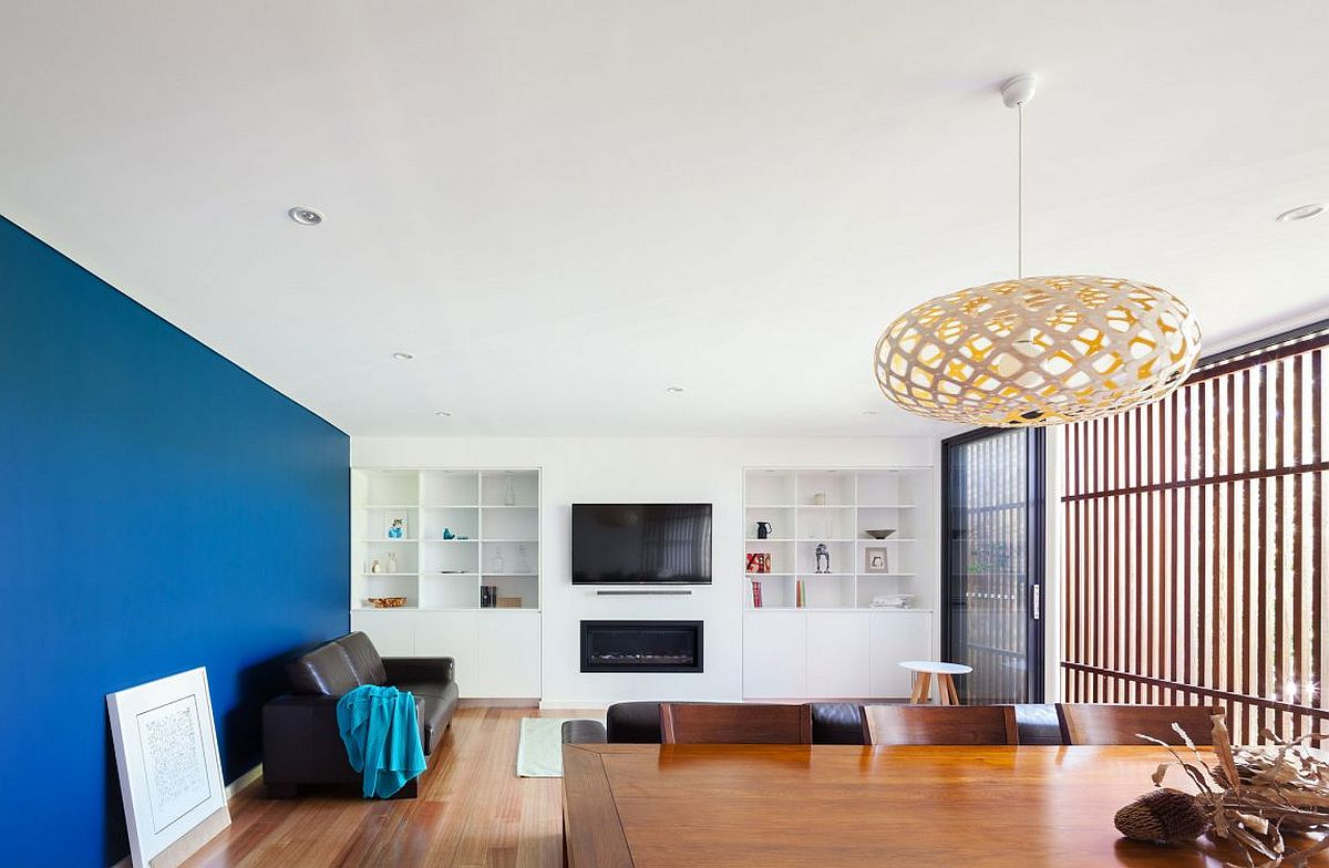 Family room with bight and cheerful blue accent wall