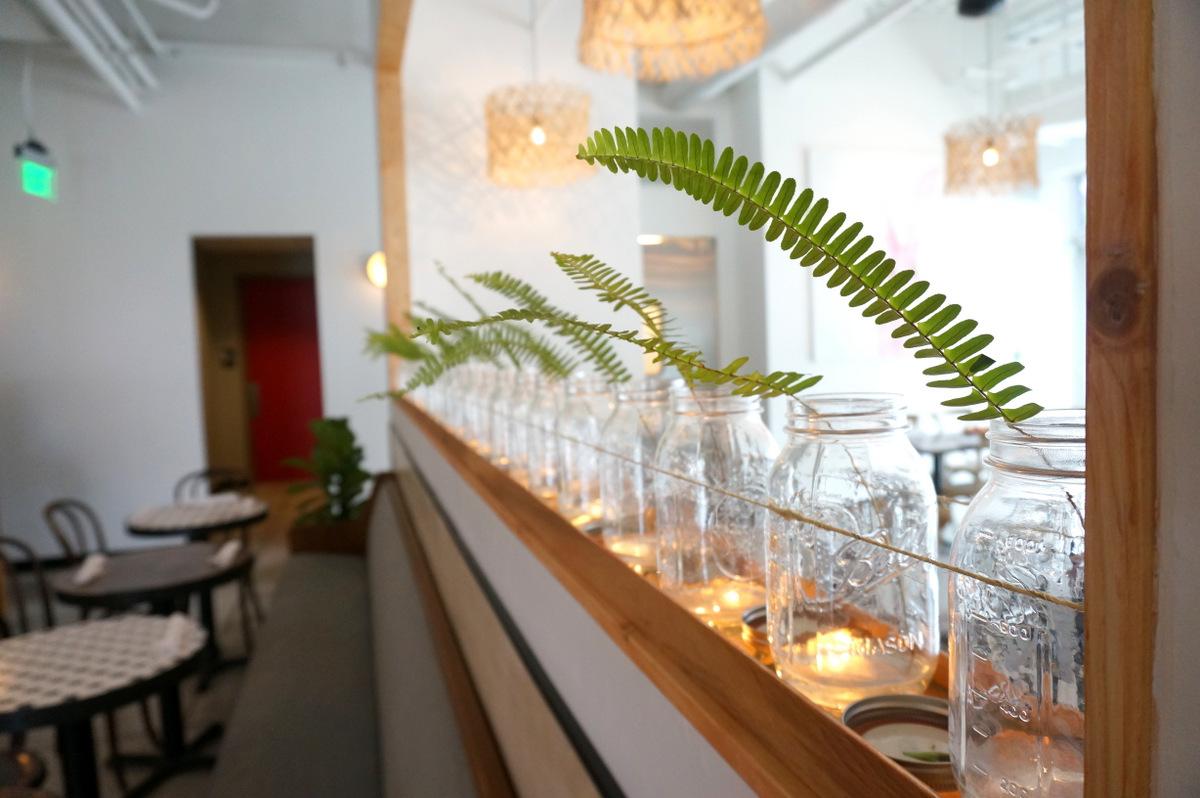 Fern fronds in mason jars add greenery