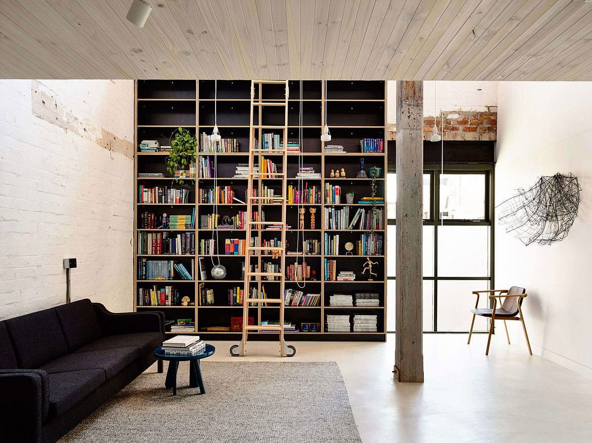 Floor-to-ceiling bookshelf adds both color and contrast to the loft home