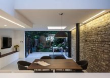 Folding glass doors connect the extension with the garden