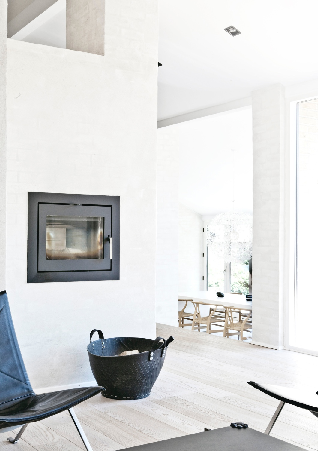 A cosy fireside corner in Fredensborg House designed by Norm Architects. Photo © Jonas Bjerre-Poulsen via ArchDaily.