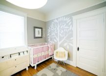 Gender neutral nursery in gray with a dash of pink