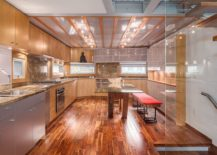 Glass-ceiling-brings-natural-light-into-the-kitchen-below-217x155