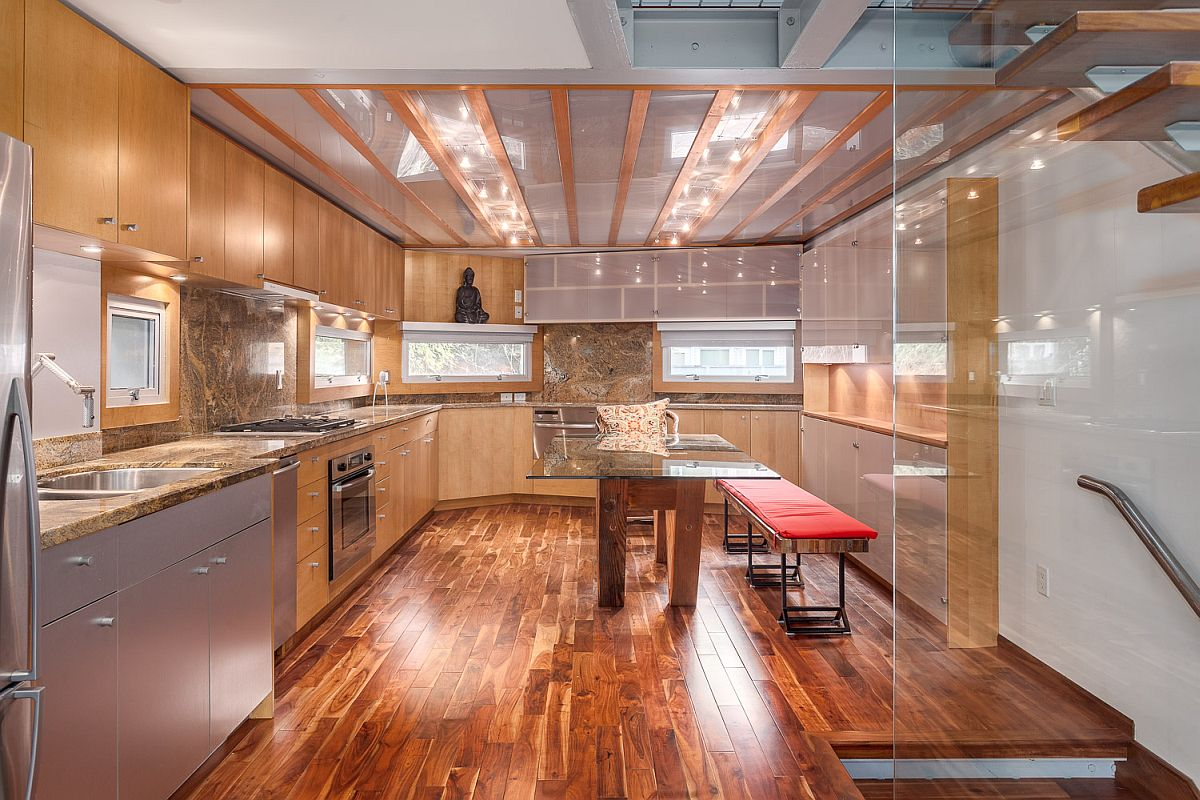 Glass ceiling brings natural light into the kitchen below