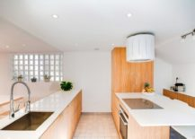 Glass-doors-and-walls-seperate-the-kitchen-from-the-living-area-217x155
