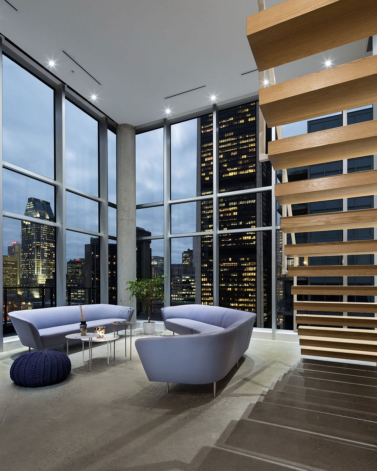 Glittering view of downtown Montreal and Stock Exchange Tower from the spacious penthouse living room