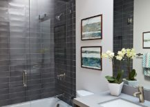 Gray-tiles-for-the-shower-area-inside-the-modern-bathroom-with-neutral-color-palette-217x155
