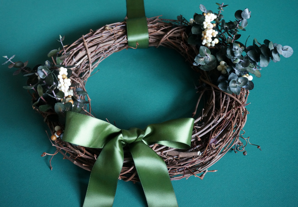 Holiday wreath with a green ribbon