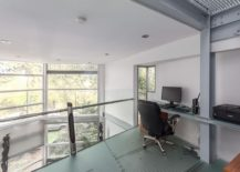 Home workspace on the top level of the duplex overlooking the living area below