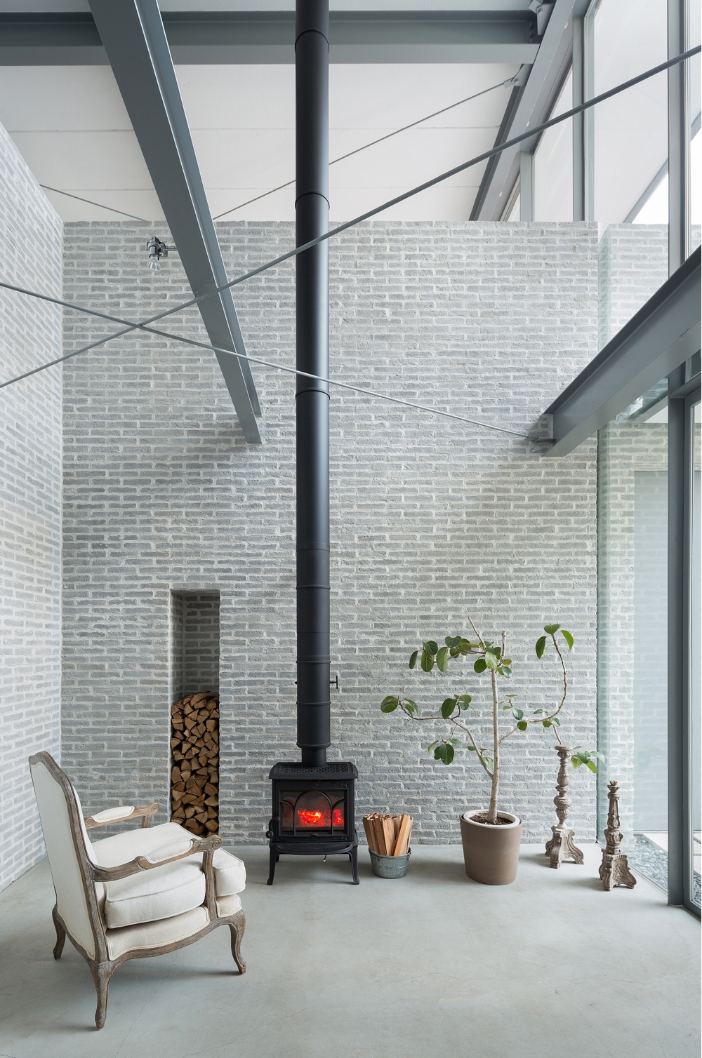 A cosy fireside in a house in Setagaya, Tokyo, by Comma Design. Image © Takumi Ota via ArchDaily.
