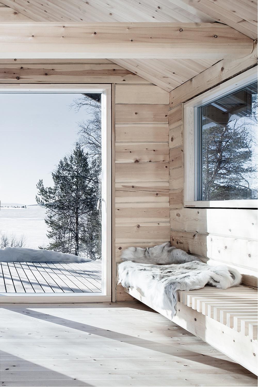 A cosy corner inHytte Femunden, a cabin designed byNorwegian architect Aslak Haanshuus.Photo byTom Gustavsen viaAslak Haanshuus Arkitekter.