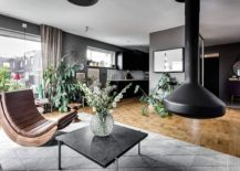 Indoor plants give teh Scandinavian apartment a refreshing and natural vibe