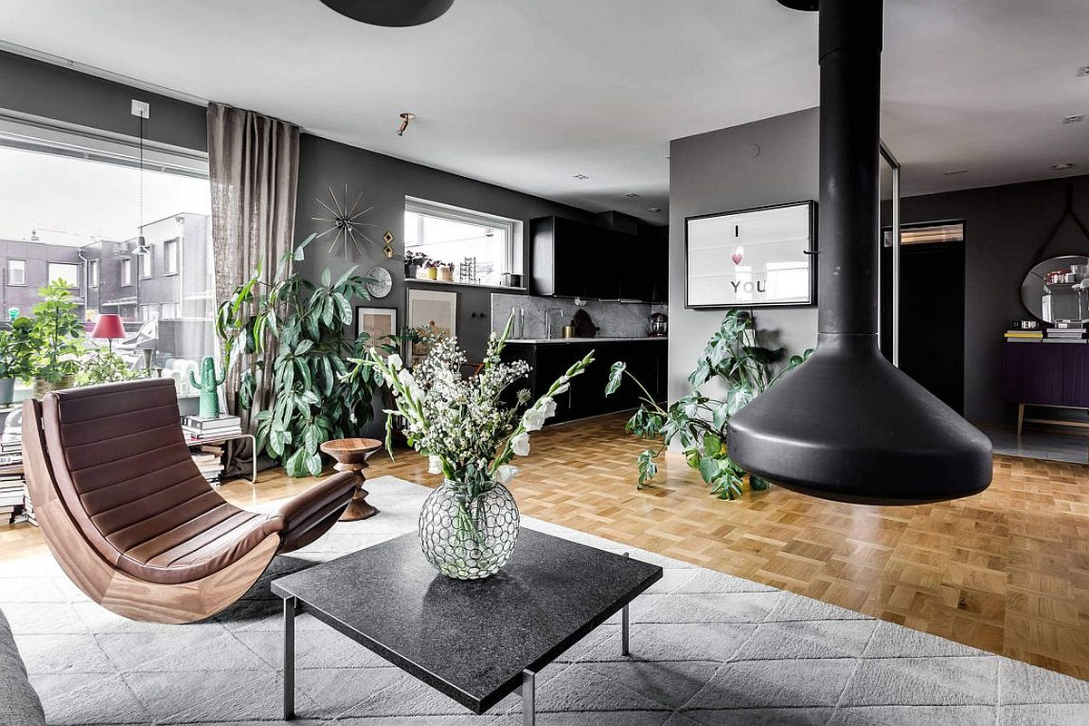 scandinavian style meets gray panache inside this stockholm apartment view in gallery indoor plants give teh scandinavian apartment a refreshing and natural vibe