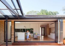 Kitchen and open family area of the Escu House in Sydney 217x155 Slated Timber Screen and a Light Filled Interior Transform 1960s Sydney Home
