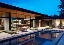 Large-glass-walls-connect-the-interior-with-the-rear-yard-and-the-pool-217x155
